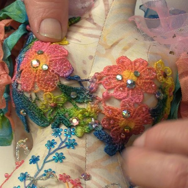 Image of embroidery and stitching on cloth doll body — from Cloth Doll Mermaids featuring Patti Medaris Culea